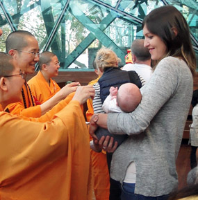 Buddhist festival: birth of my first Aussie grandchild